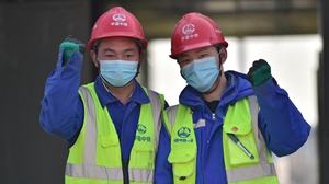Father and son in construction site of COVID-19 quarantine center