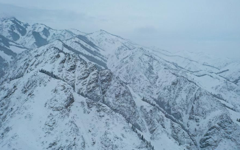 View of snow-covered Cheshi Ancient Trail in Xinjiang