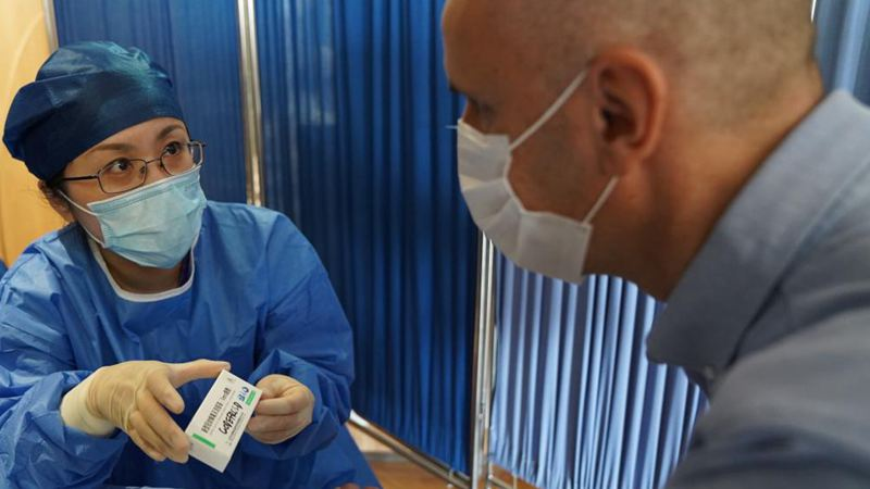 Feature: Expats receive COVID-19 vaccine in Shanghai