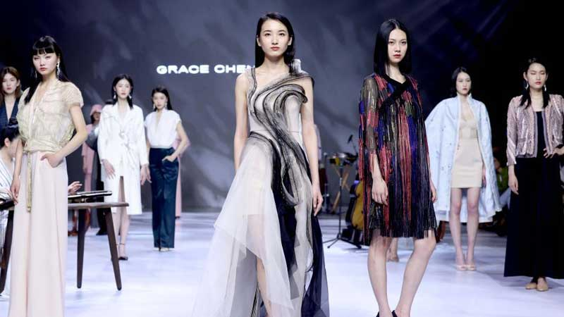 Models present creations of Grace Chen during China Fashion Week in Beijing