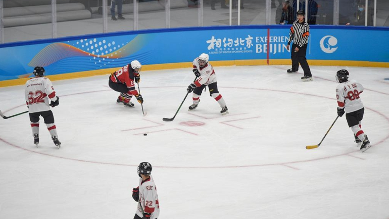 Players compete during ice hockey test program at National Indoor Stadium in Beijing