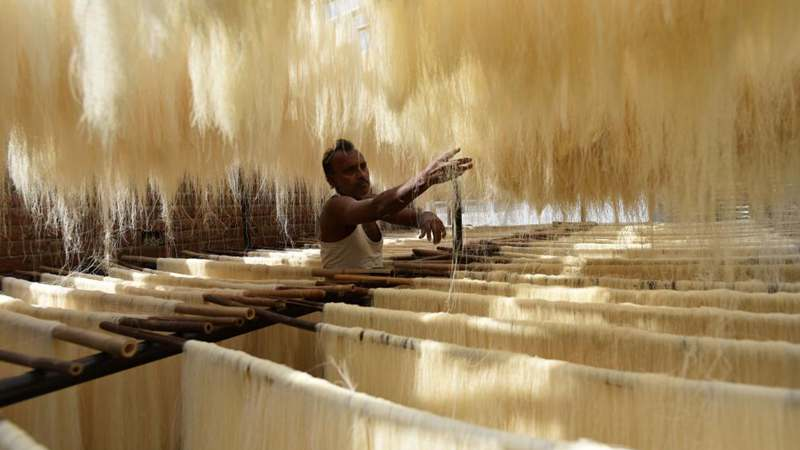 People prepare vermicelli noodles during fasting month of Ramadan in India