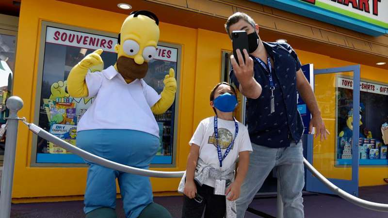 People visit Universal Studios Hollywood during preview in Los Angeles