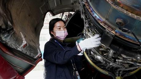 Pic story of female mechanic in Henan