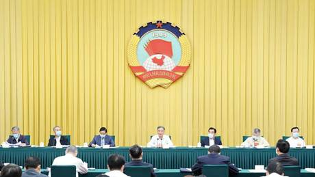 Top political advisor stresses strengthening public communication