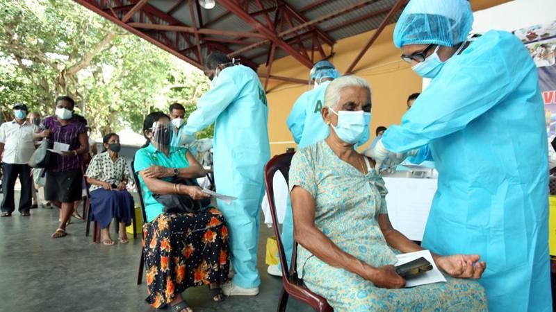 People receive COVID-19 vaccines in Sri Lanka