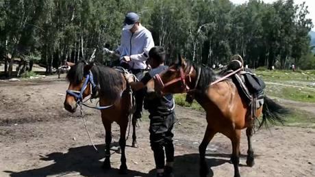 Enjoy horse riding at Kanas scenic area in China's Xinjiang