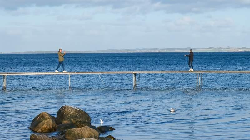 """People walk on """"The Infinite Bridge"""" in Aarhus, Denmark"""
