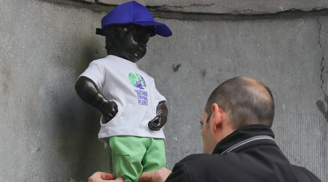 Manneken-Pis in Belgium dressed to show support for upcoming COP26