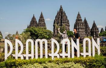 People visit Prambanan temple complex in Indonesia