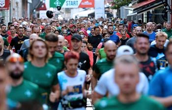 Participants compete during half marathon event marking European Sports Week in BiH