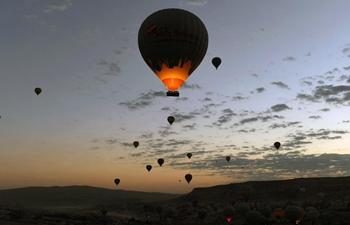 Hot-air balloons fly over Cappadocia, Turkey
