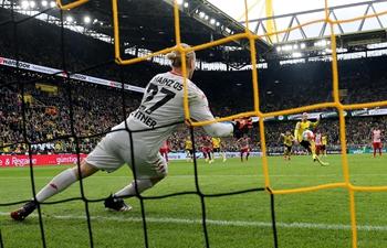 Dortmund overpower Mainz 3-1 and take top spot in Bundesliga