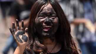 People revel at Mojiang Hani carnival in SW China