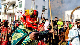 Folk artists perform Nuo dance to greet Chinese Lunar New Year in E China