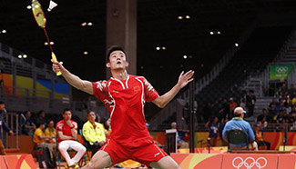 China's Chen Long wins 2-0 during men's singles group play stage match of Badminton