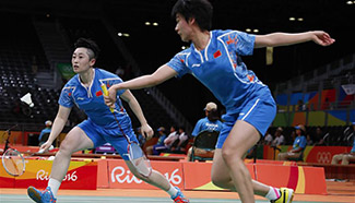 China's Yu Yang, Tang Yuanting win 2-1 during women's doubles group play stage match of badminton