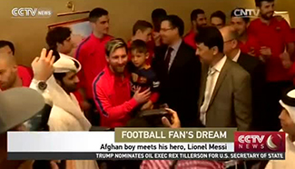 Afghan boy meets his hero, Lionel Messi
