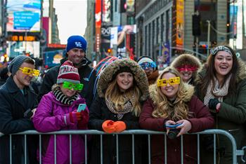 People wait to attend New Year celebration at Times Square in NYC