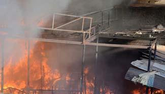 Fire breaks out inside furniture market in Pakistan