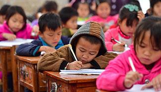 Students take exam before winter vacation, south China