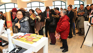 Stamp collectors wait to buy the Year of Rooster stamps in Toronto