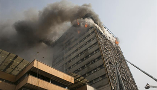 At least 30 killed in Tehran's building fire