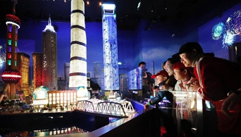 Children view architectural models at LEGOLAND Discovery Center in Shanghai