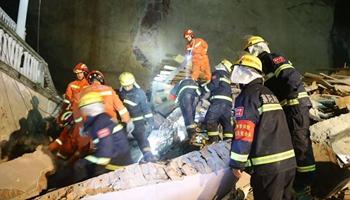 14 buried in central China landslide