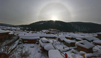 Solar halo appears over snow-covered scenic spot in NE China
