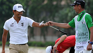 Golf players compete during Singapore Open