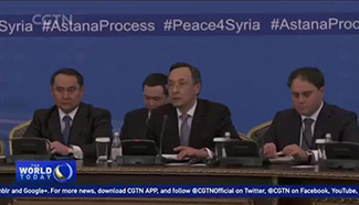 Syrian peace talks begin with tense exchanges