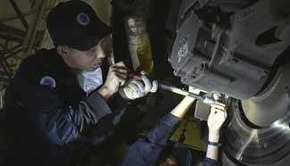 Mechanics maintain bullet train for Spring Festival travel rush