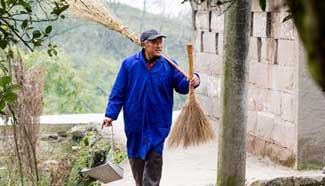 Pic story: Qin Guanxiao, beneficiary from poverty alleviation plan