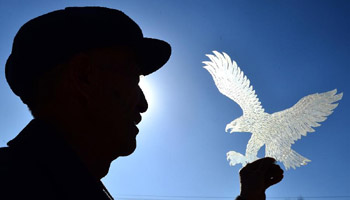 Artisan engages in shadow puppet making in NW China