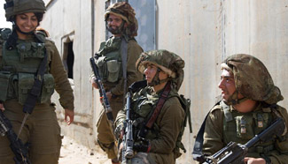 Soldiers take part in training exercise in Negev desert, Israel
