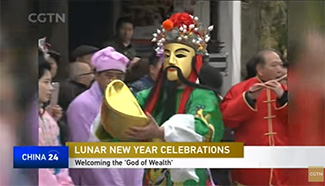 People across China welcome the 'God of Wealth'