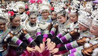 People of Miao ethnic group dance to celebrate Spring Festival
