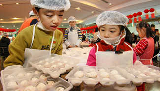 Children learn to make Yuanxiao in E China to mark Lantern Festival
