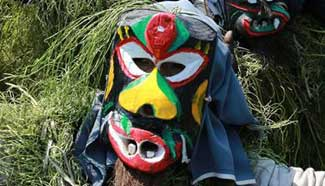 """Villagers perform in costumes of """"Mang Ge"""" during local festival in south China"""