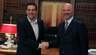 Greek PM meets with Pierre Moscovici in Athens