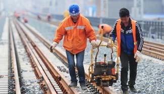 Workers adjust Wuhan-Jiujiang Passenger Railway in Jiangxi