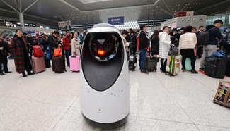 Robot patrols at railway station in C China's Henan