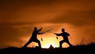 People practise taiji at sunrise in N China