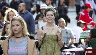 People enjoy warm weather in New York City
