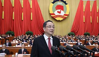 Top political advisor delivers report on work of CPPCC National Committee's Standing Committee