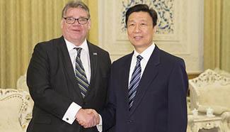 Li Yuanchao meets with Finnish FM in Beijing