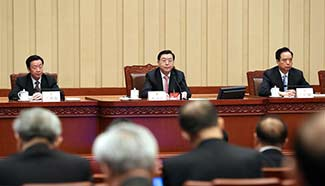 Top legislator presides over 1st presidium meeting of 5th session of 12th NPC