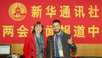 Xinhua News Agency sends foreign journalists to cover annual sessions