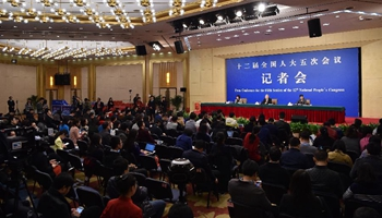Director answers questions on poverty alleviation at NPC press conference